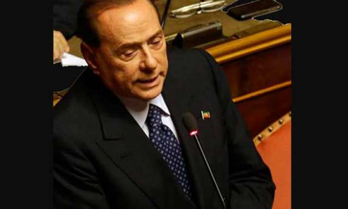 berlusconi defeated decides to back italy government