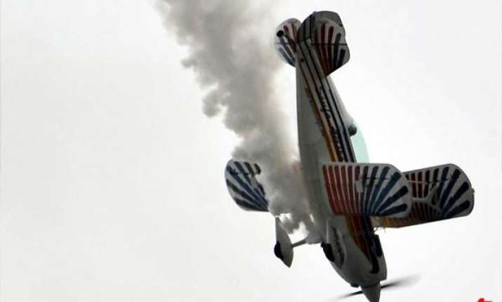 biplane crashes during air show plunges into river