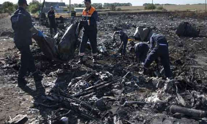 malaysia jet victims bodies arrive in netherlands