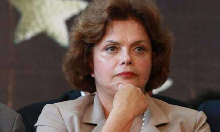 brazilian president exonerated in probe of refinery deal