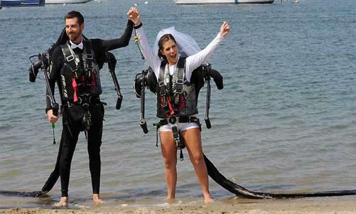 californian couple marry in air wearing jetpacks