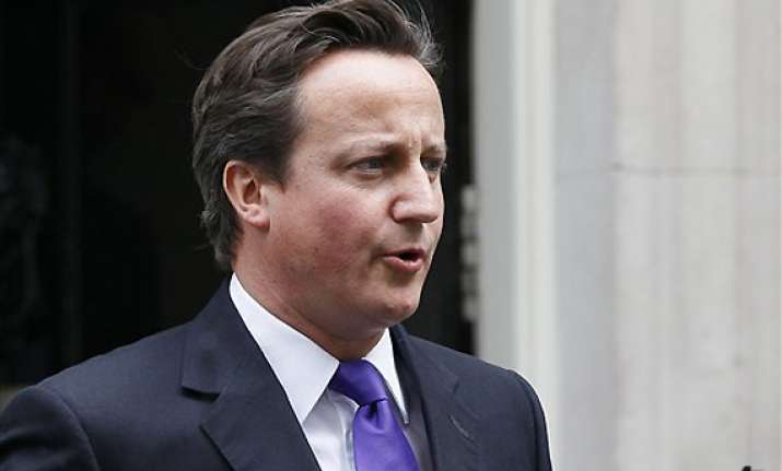 cameron defends actions but offers regret in hacking scandal
