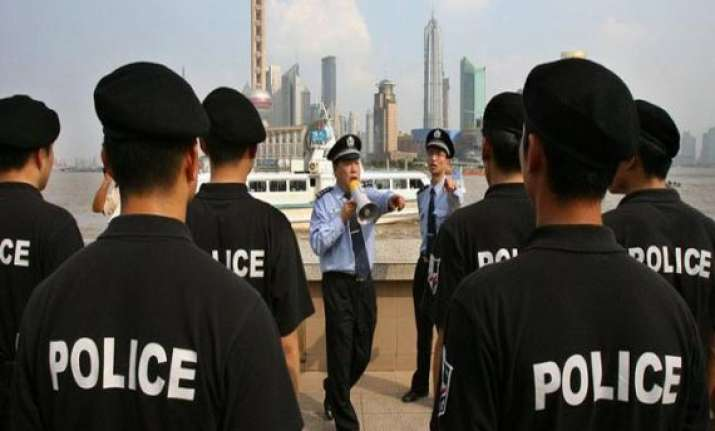 china arrests british american investigators