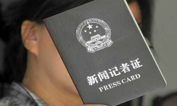 china cancels over 14 400 press cards for journalists