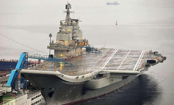 china s aircraft carrier anchors at military port