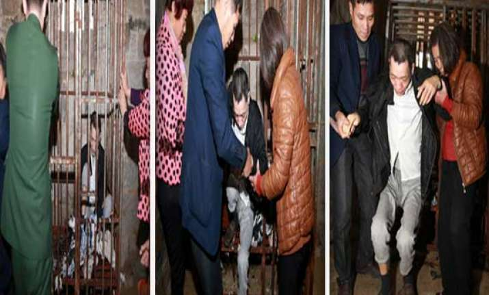 chinese woman locks mentally ill son inside iron cage for