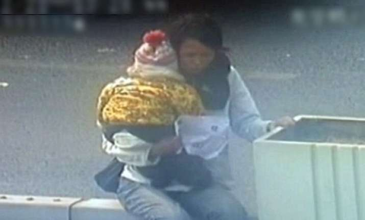 cctv footage of chinese cop saving woman kid trying to jump