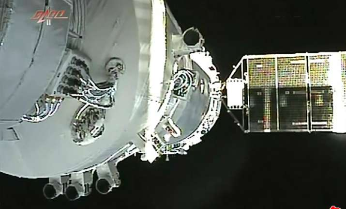 chinese craft returns from space docking mission