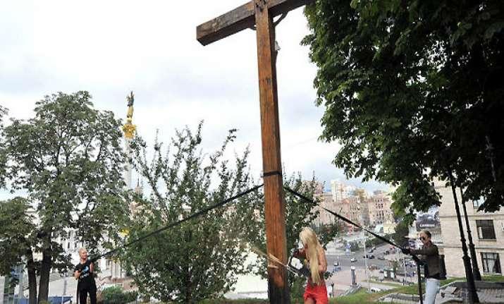 cross chopping topless activist flees ukraine