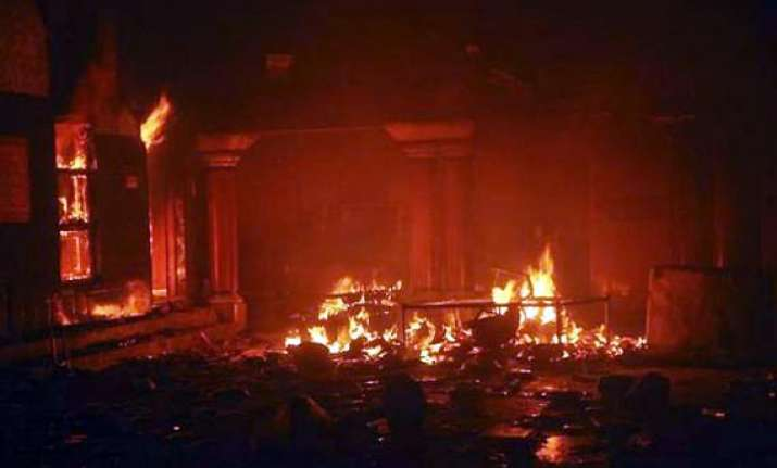 curfew in larkana muslim mobs set fire to hindu temple
