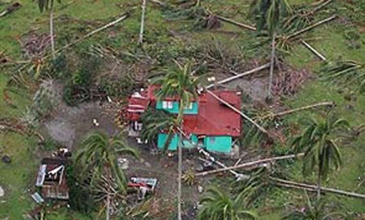 cyclone evan knocks out power and bridges in fiji