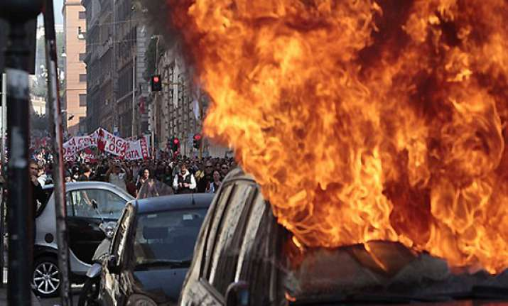 cars set on fire in rome worldwide protests against