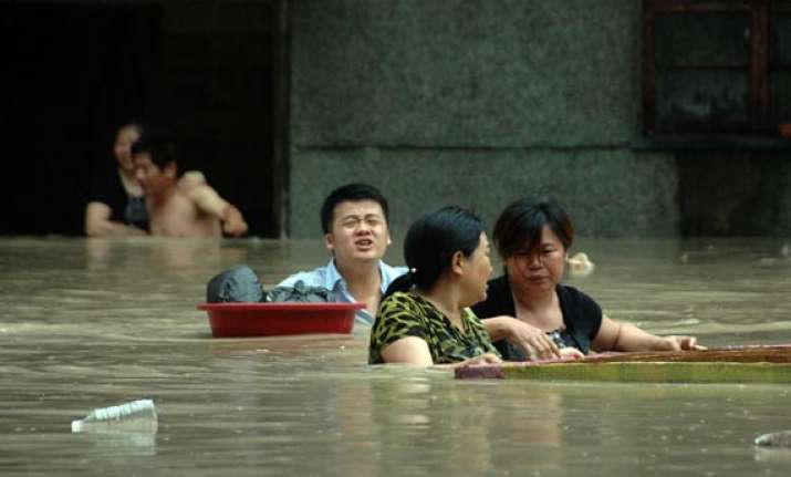 death toll in china floods rises to over 100