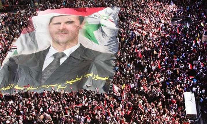defiant assad brushes off threat of sanctions