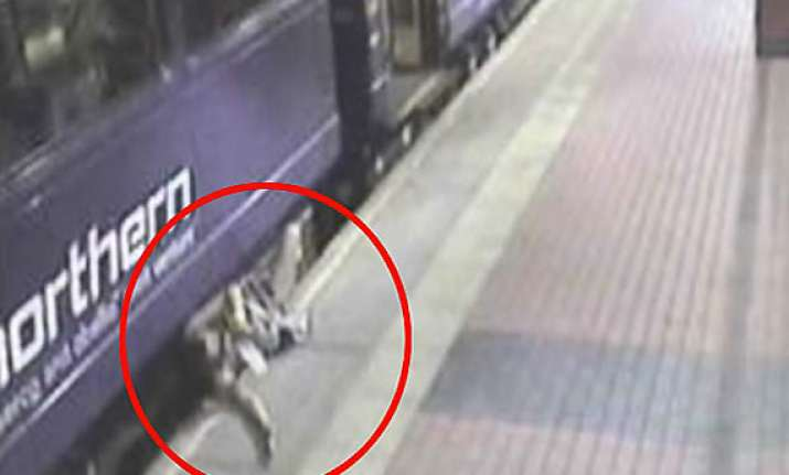 drunk woman falls into gap between a train and the platform