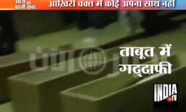 dubai based tv broadcasts amateur video of gaddafi s funeral