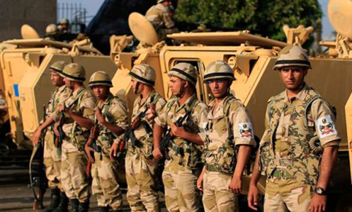 egypt unrest 34 killed in clashes outside cairo military