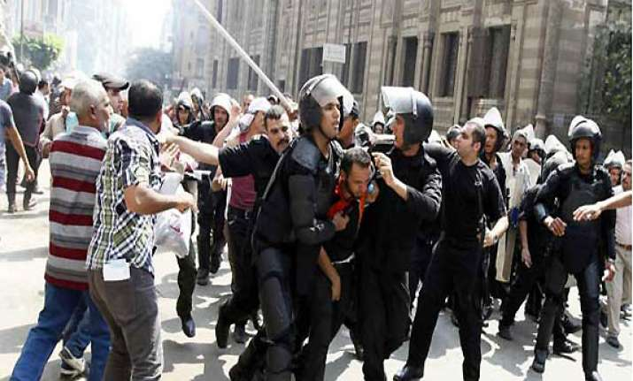 egyptian riot police fire tear gas at protesters