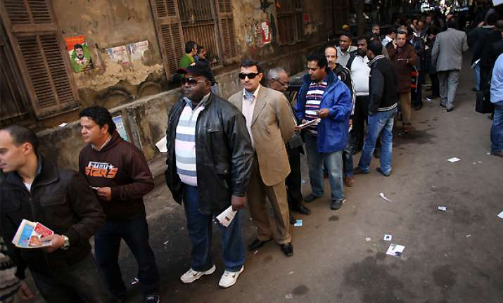 egyptians wait in long lines to elect a parliament