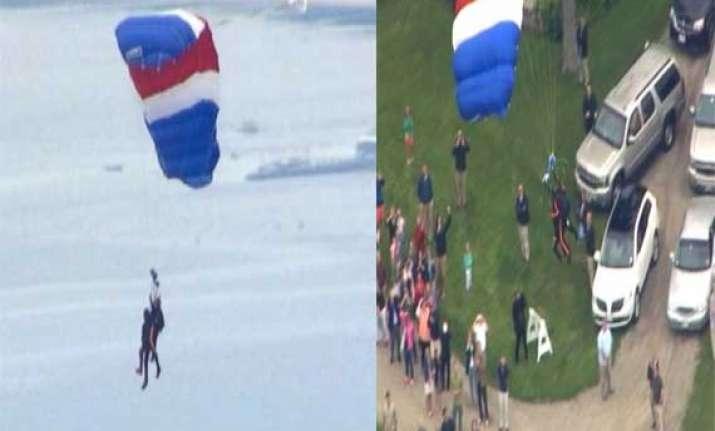 former us president george bush skydives on 90th birthday