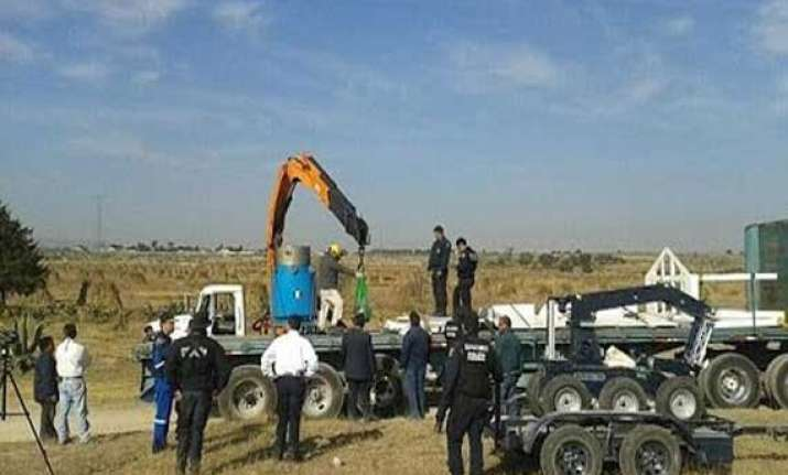 four held in china over missing radioactive source