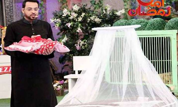 furore over pak tv quiz show host gifting orphan baby to