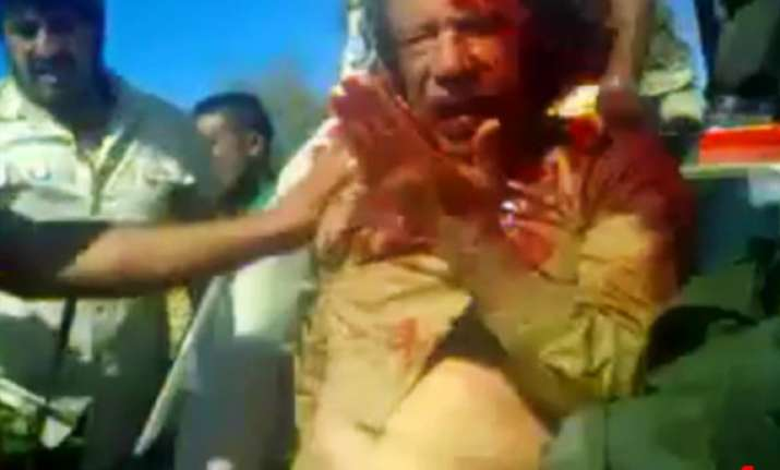 gaddafi begged for life offered gold money to captors