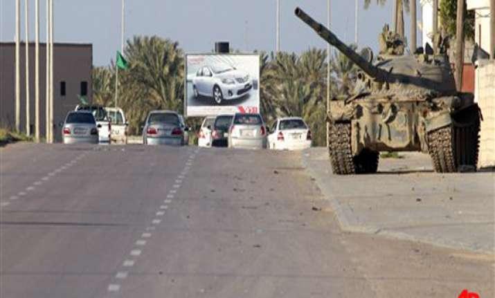 gaddafi forces push towards ajdabiya 5 killed in misurata