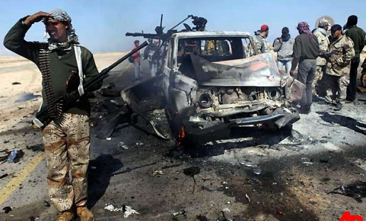 gaddafi onslaught pushes rebels back from brega