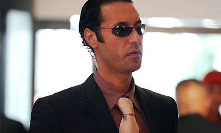 gaddafi son held as libya fighters mop up resistance