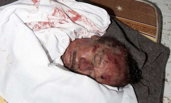 gaddafi son mutassim buried in unmarked desert graves son