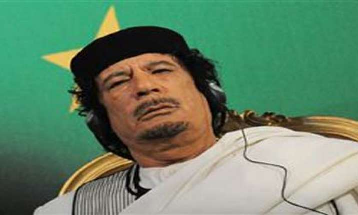 gaddafi threatens to attack west over airstrikes