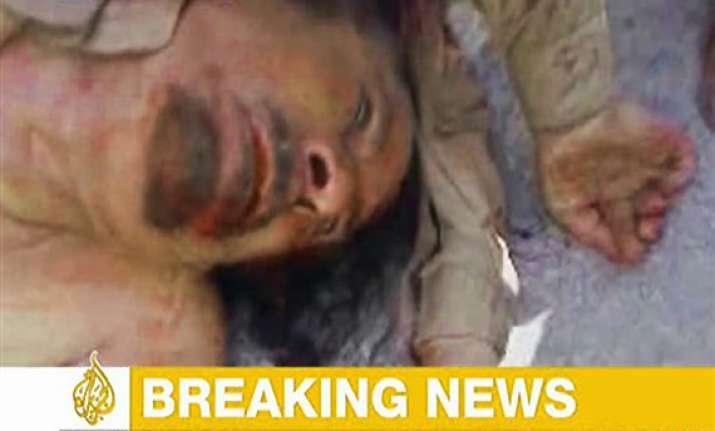gaddafi s body was kicked around on streets of sirte died