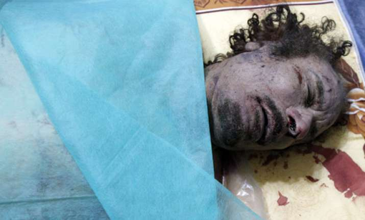 gaddafi s daughter demands icc probe into father s death