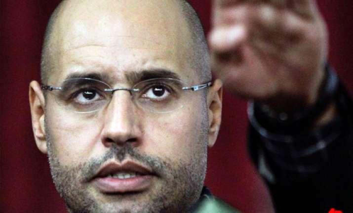 gaddafi s son seif al islam arrested icc prosecutor