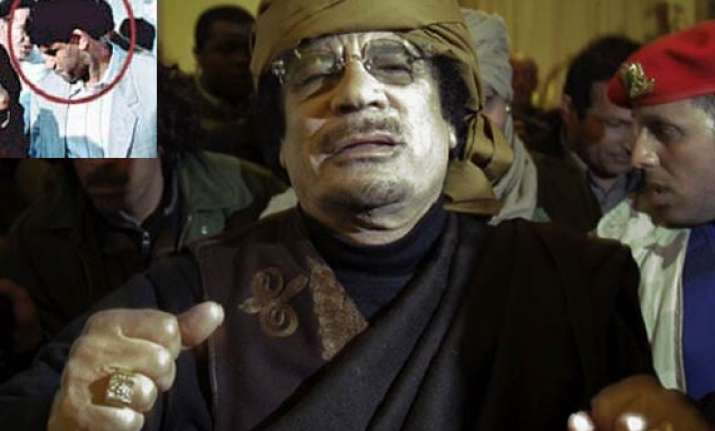 gaddafi s spymaster taken seif to be tried in libya