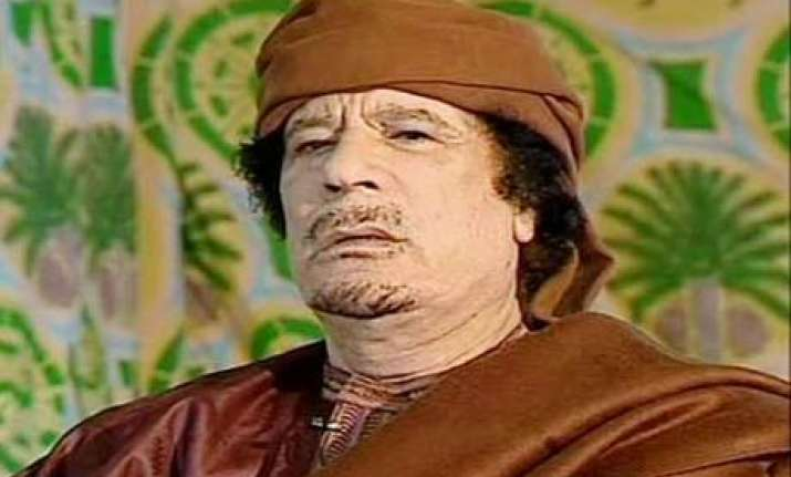 gadhafi may be wounded on the run says italian minister
