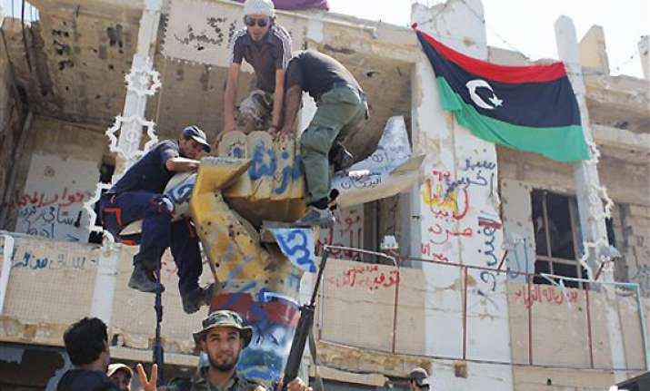 gadhafi spokesman libyan leader leading the fight
