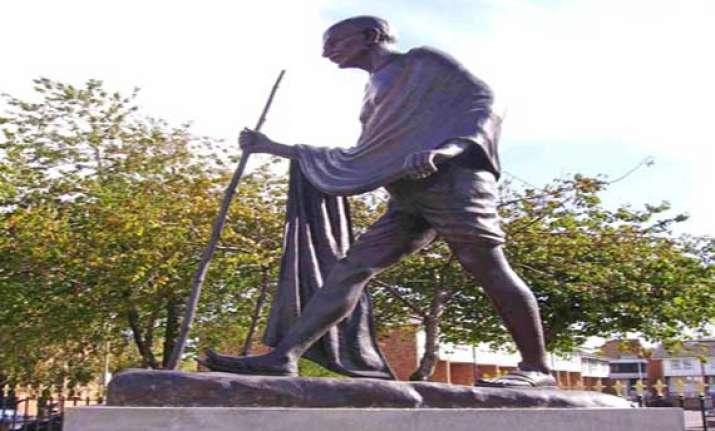 gandhi statue vandalised amid sikh protests over operation