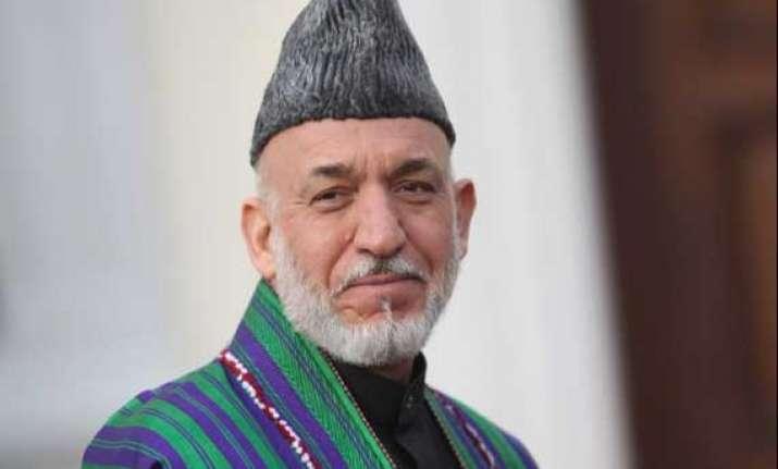 hamid karzai casts vote in presidential runoff polls