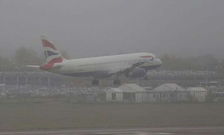 heathrow airport cancels 60 flights due to fog