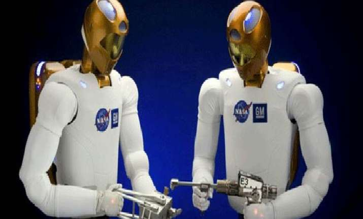 human and humanoid robot shake hands in space