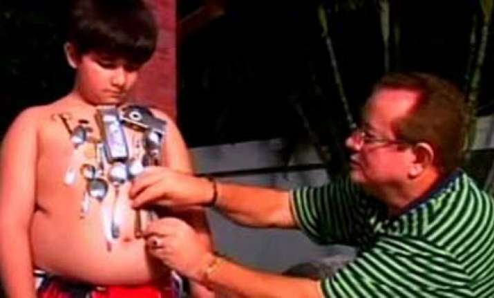 human magnet brazil boy attracts metal objects to his body