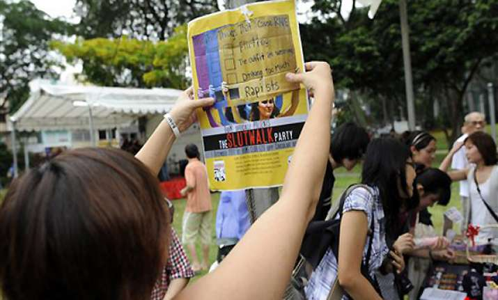 hundreds gather for singapore slutwalk protest