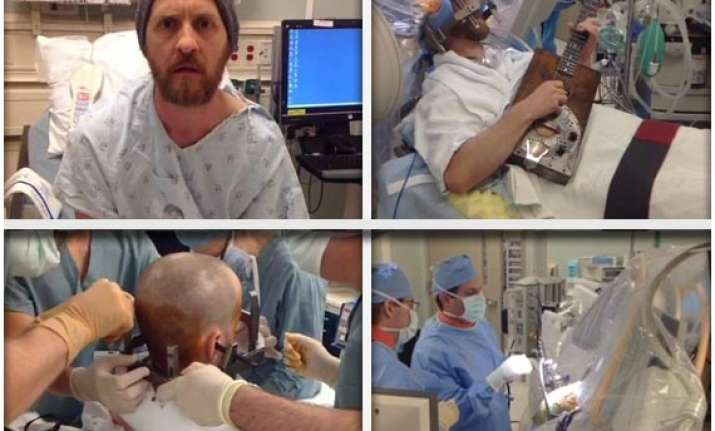 incredible man plays guitar during his brain surgery in los
