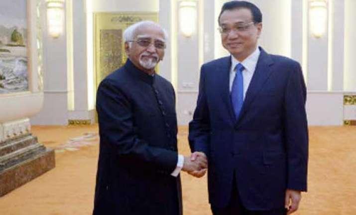 india china have to narrow down differences hamid ansari