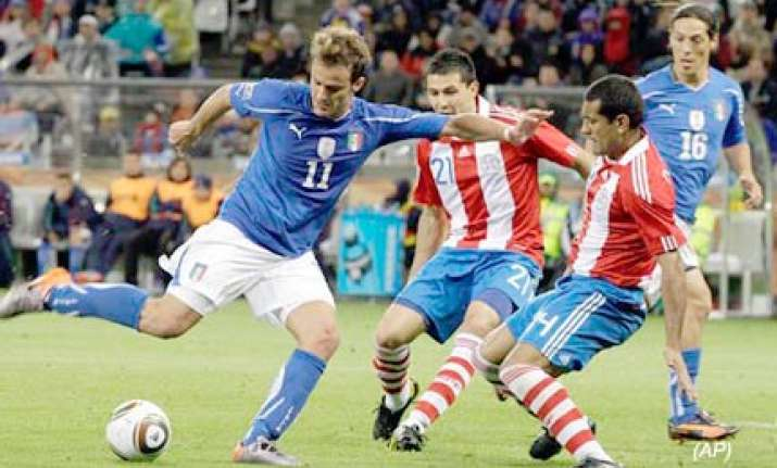 defending champions italy draw 1 1 with paraguay