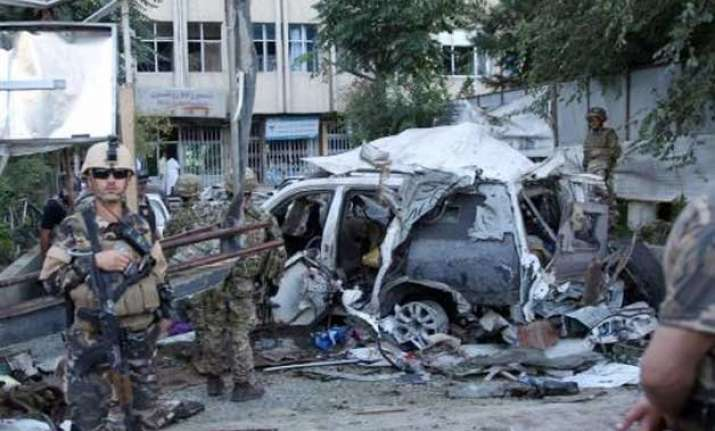 afghan car bombing kills at least 12 including 3 americans