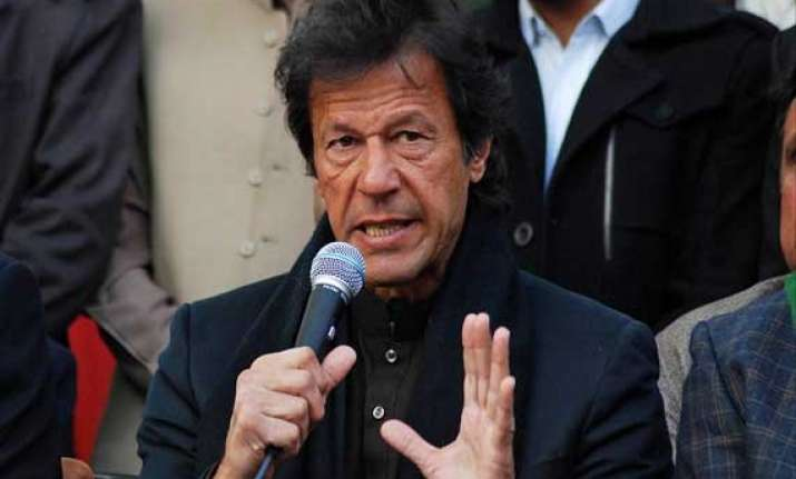 imran ends protest in pakistan capital after peshawar attack