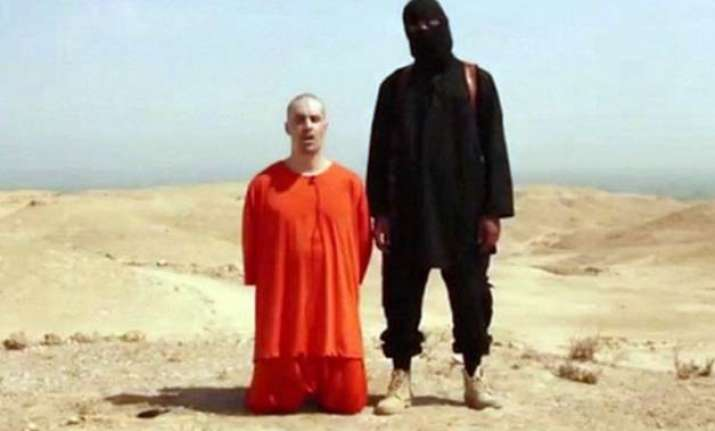 the beheading man in is videos is a briton bbc